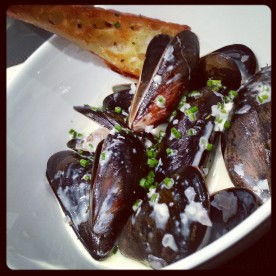 Jubilee Sparkling Sevyal Naturel Poached Mussels Creamy Herb Broth with Buttered Baguette Toast